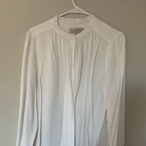Lightly worn, white button blouse